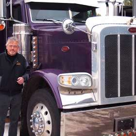 Randy standing beside Peterbilt truck
